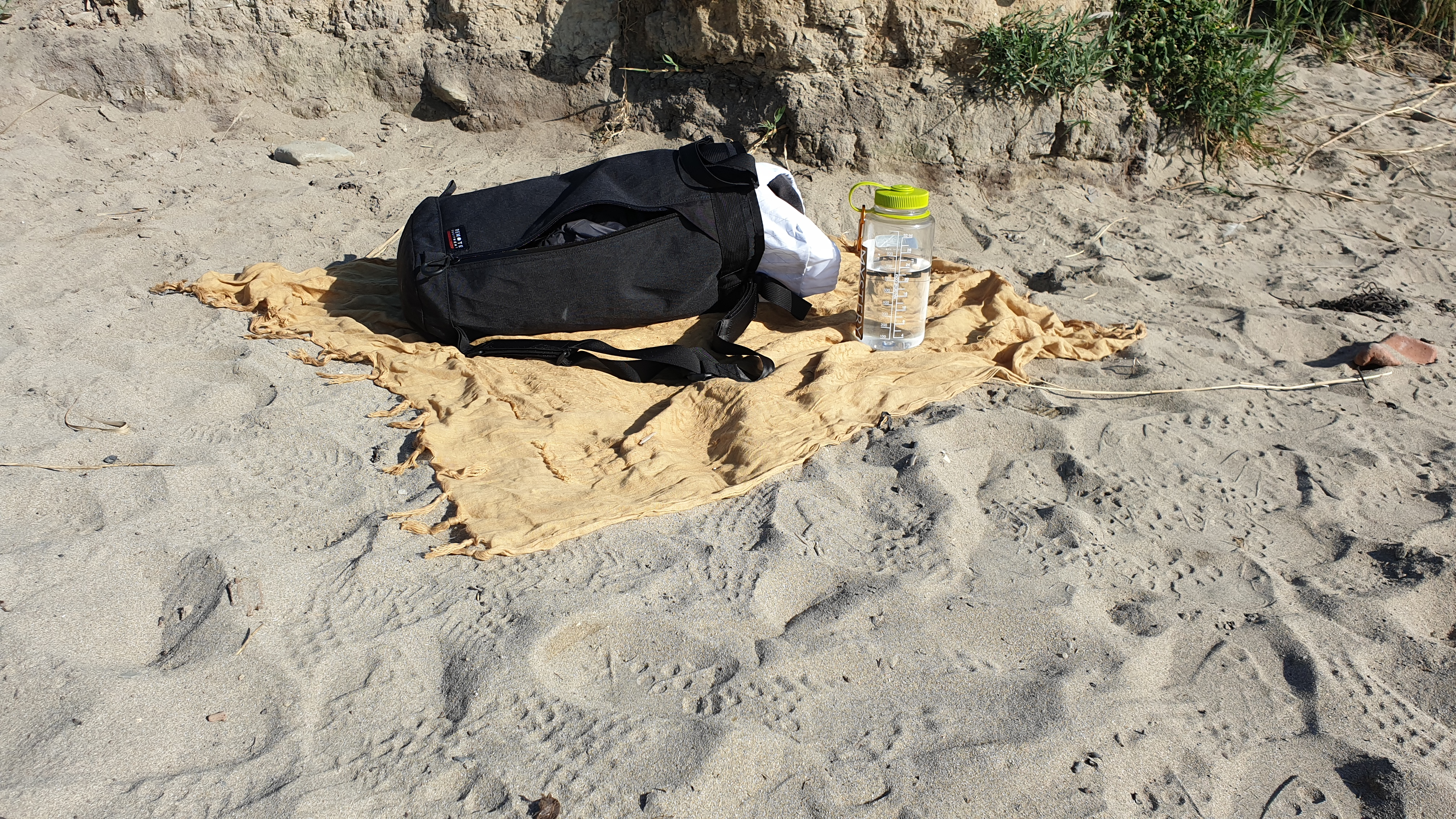 Remote Equipment Bravo 18 travel bag review on beach with shemagh nalgene bottle
