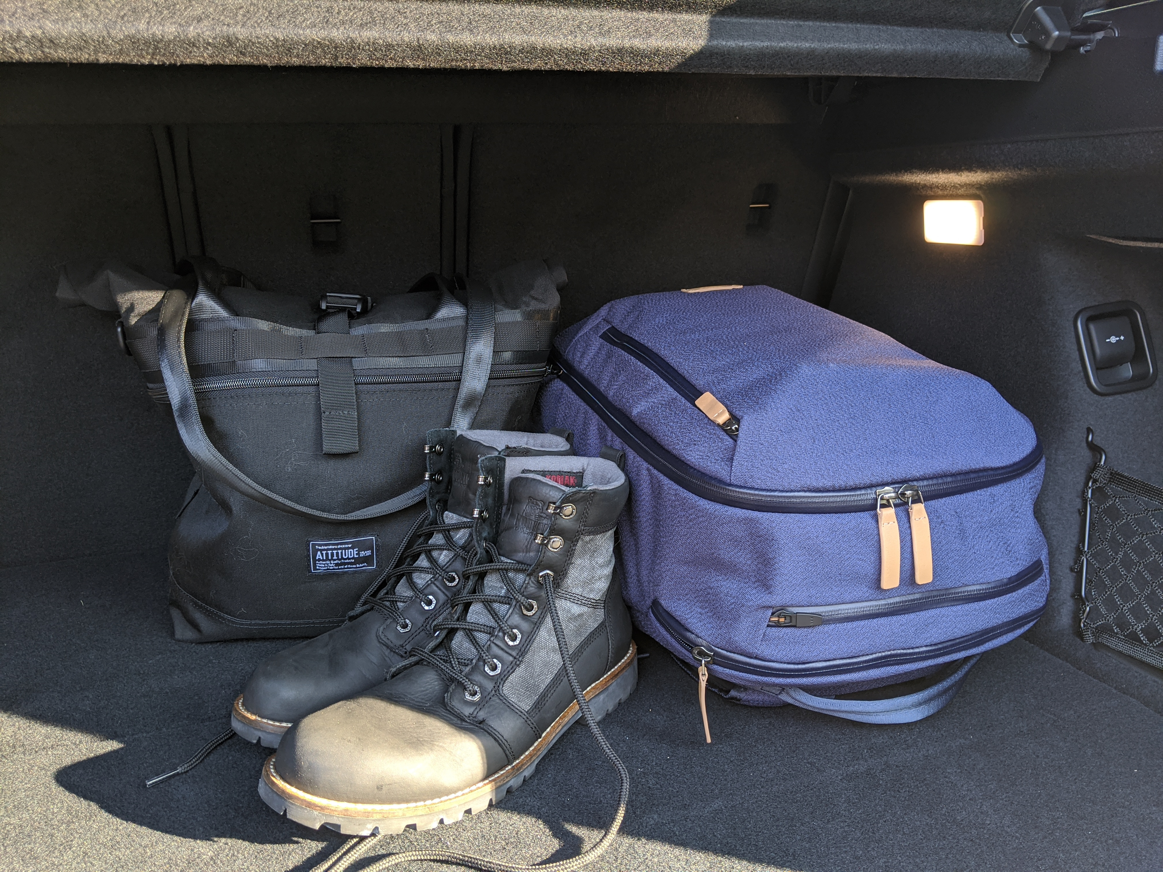 Bellroy Transit Review in back of car with boots and tote