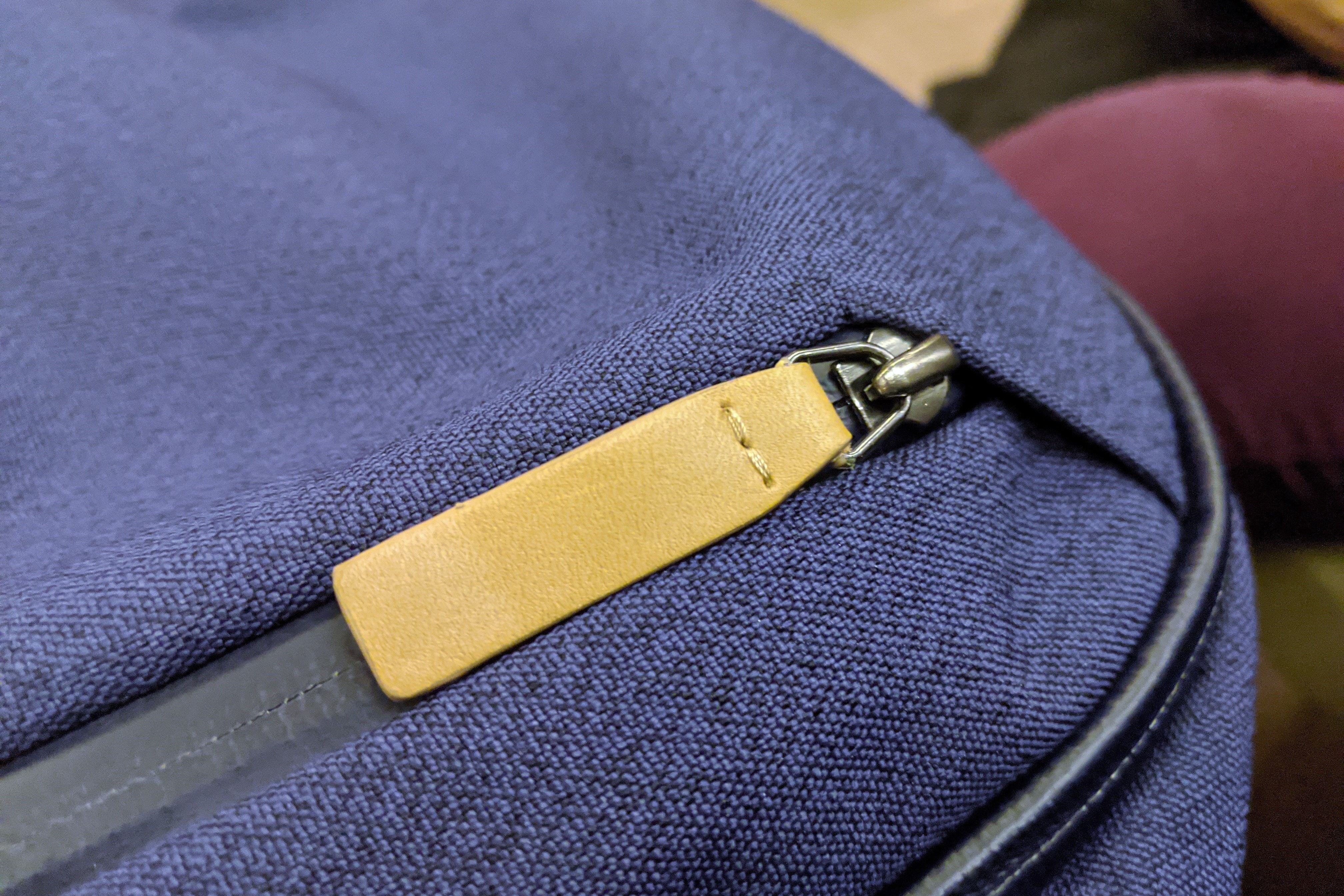 Bellroy Transit Review leather zipper accent